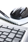 Computer mouse and notebook with pen Royalty Free Stock Photos