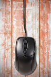 Computer  mouse on the old wooden planks Royalty Free Stock Images