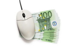 Computer mouse and one hundred euro banknotes. On white Royalty Free Stock Image