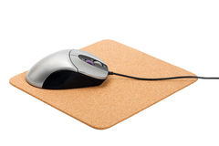 Computer mouse on pad Royalty Free Stock Image