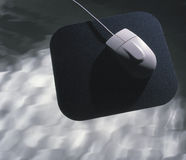 Computer mouse on pad Royalty Free Stock Photography