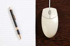 Computer mouse and pen with paper Royalty Free Stock Images