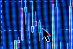 Computer mouse pointer on stock chart Royalty Free Stock Photos