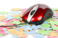Computer mouse and puzzle Royalty Free Stock Photo