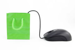 Computer mouse and shopping bag Royalty Free Stock Photography