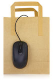 Computer mouse and shopping bag Stock Images