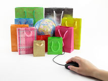 Computer mouse and shopping bags Royalty Free Stock Photo