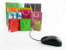 Computer mouse and shopping bags Stock Image