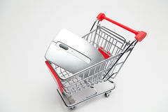 Computer mouse in shopping cart Stock Image