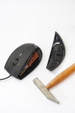 Computer mouse smashed with hammer Royalty Free Stock Photo