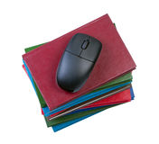 Computer mouse on stack of books. Stock Photography