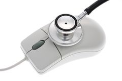 Computer mouse and stethoscope Stock Images
