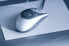 Computer mouse on tablet Stock Photo