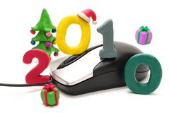 Computer Mouse, Text 2010. 3D New Year Text 2010 with Christmas Tree and Gifts Made of Colored Plasticine and Computer Mouse Isolated on White Background Royalty Free Stock Image