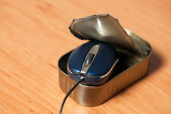 Computer mouse in tin can Royalty Free Stock Image