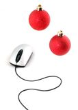Computer mouse with two christmas red balls Stock Photography