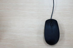 Computer mouse on wooden background. Top view Royalty Free Stock Image