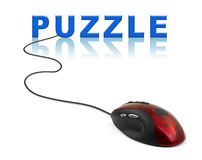 Computer mouse and word Puzzle Royalty Free Stock Photos