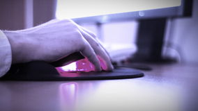 Computer mouse used by office worker. Worker's hand close-up. Using computer mouse stock footage