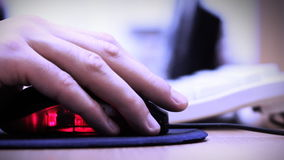 Computer mouse used by office worker stock footage