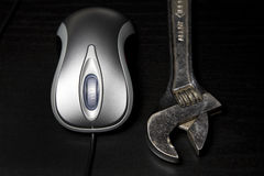 Computer mouse and wrench Royalty Free Stock Photo