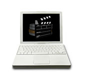Computer Movie Making. Computer with slate and film cans on screen Royalty Free Stock Images