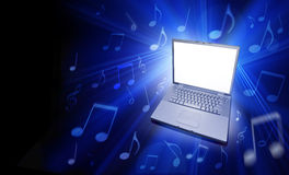 Computer Music. A laptop computer on a black background with musical notes floating around with a blank screen  itunes streaming online service app apps media Royalty Free Stock Images