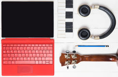 Computer Music producing equipment. Song writing equipments on wooden table Royalty Free Stock Photos