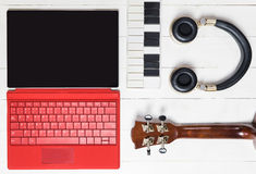 Computer Music producing equipment. Song writing equipments on wooden table Stock Images