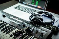 Computer Music Studio equipment with sunglasses Stock Images