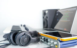 Computer music work station with headphone stock photography