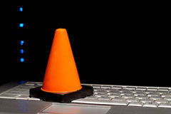 Computer Needing Repair. PC needing repair symbolised by hazard cone. Plenty of copy space on screen stock photography