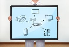 Computer network. Businessman holding a plasma with computer network Royalty Free Stock Image