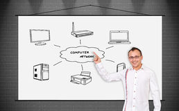 Computer network. Cheerful businessman pointing to poster with computer network Stock Images