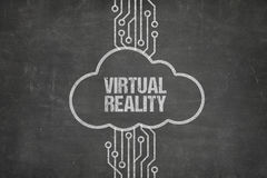 Computer Network Connecting To Virtual Reality Text In Cloud. Closeup of computer network connecting to virtual reality text in cloud on blackboard Royalty Free Stock Photos