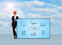Computer network. Woman engineer holding plasma panel with computer network Royalty Free Stock Photo