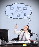 Computer network. Young businessman sitting  in office and dreaming at computer network Stock Photo