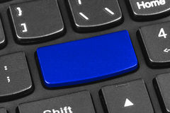 Computer notebook keyboard with blank blue key Stock Image