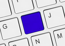 Computer notebook keyboard with blank blue key Stock Photography