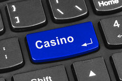 Computer notebook keyboard with Casino key Stock Photos
