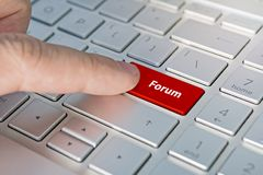Computer notebook keyboard with Forum key - technology background royalty free stock image