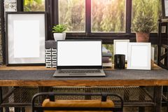 Computer Notebook or laptop with blank screen and empty picture stock photography