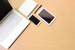 Computer notebook laptop with digital tablet and white smartphon Royalty Free Stock Photography
