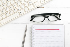 Computer and notepad Royalty Free Stock Images