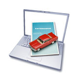 Computer Online Car Insurance. A laptop computer with a car insurance brochure and toy car coming out of the screen