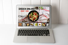 Computer with Online food delivery app on screen. lifestyle conc stock photo