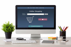Computer with online shopping site with phone and watch Royalty Free Stock Images