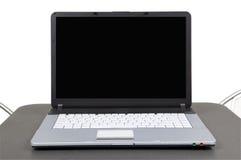 Computer op grijze lijst Stock Foto's
