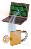 Computer, padlock and key Stock Photography