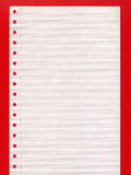 Computer paper. Blank perforated computer paper over red background Royalty Free Stock Photography